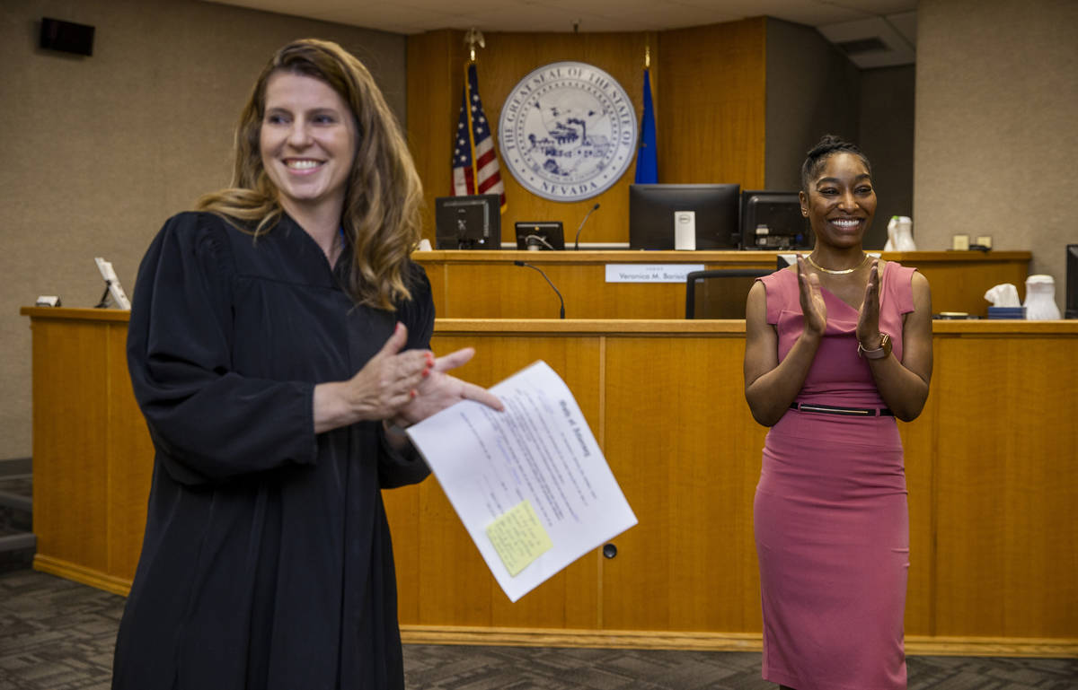 Dominique Bosa-Edwards, right, a former District Court marshal, is applauded after being sworn ...