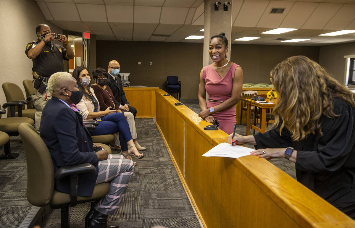 Dominique Bosa-Edwards, center, a former District Court marshal, who passed the Nevada State Ba ...