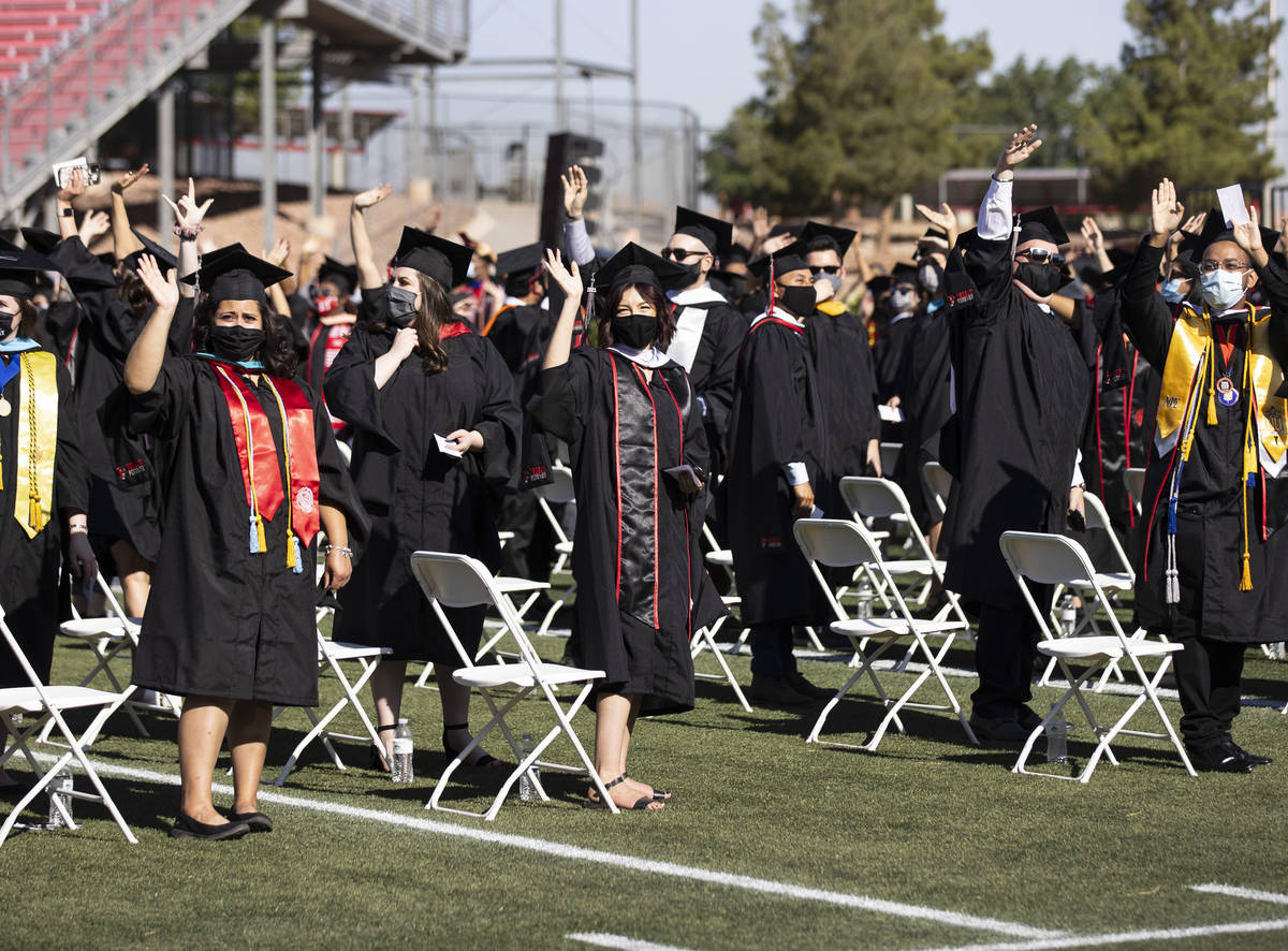 Graduates wave to their parents during the first of several UNLV graduation ceremonies at Sam B ...