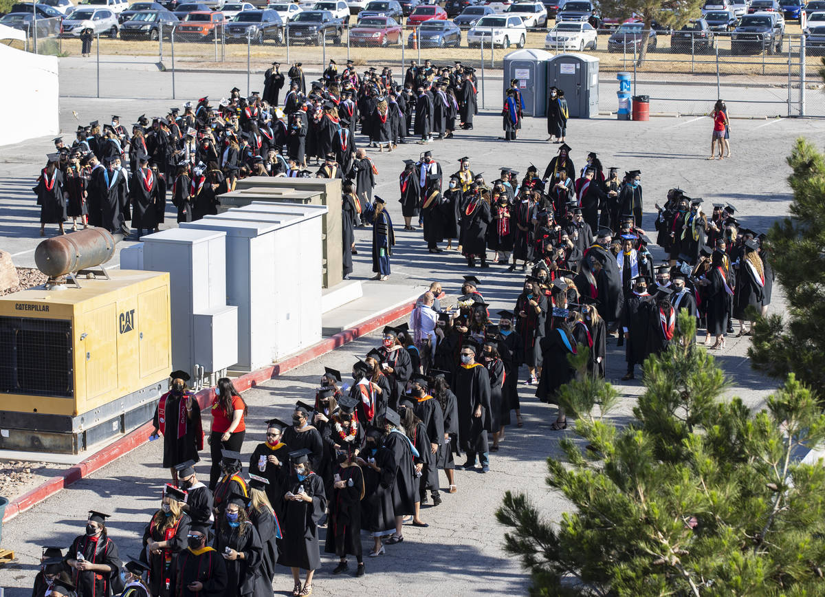 Graduates lined up to attend the first of several UNLV graduation ceremonies at Sam Boyd Stadiu ...