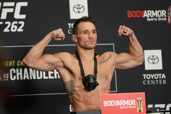 Michael Chandler jumps on the scale for the UFC 262 Official Weigh-in on May 14, 2021, at Marri ...