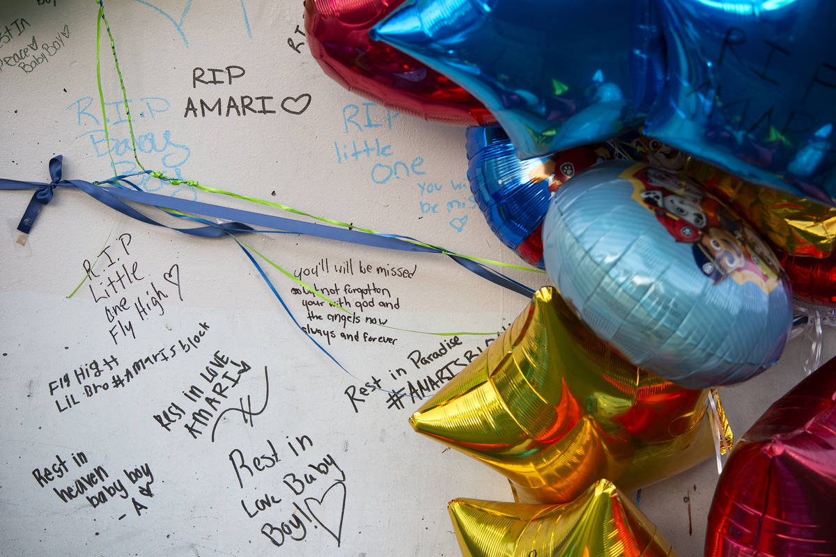 Mourners wrote notes on a pillar outside the Emerald Suites near where 2-year-old Amari Nichols ...
