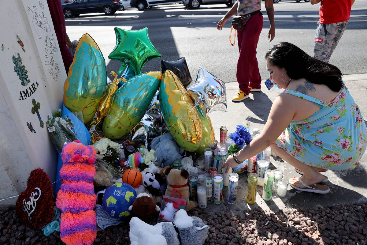 Olivia Vega places flowers at Emerald Suites on Paradise Road near where the body of missing La ...