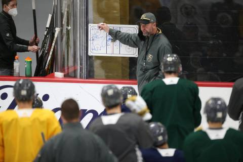 Vegas Golden Knights head coach Peter DeBoer talks to his team during a practice at City Nation ...