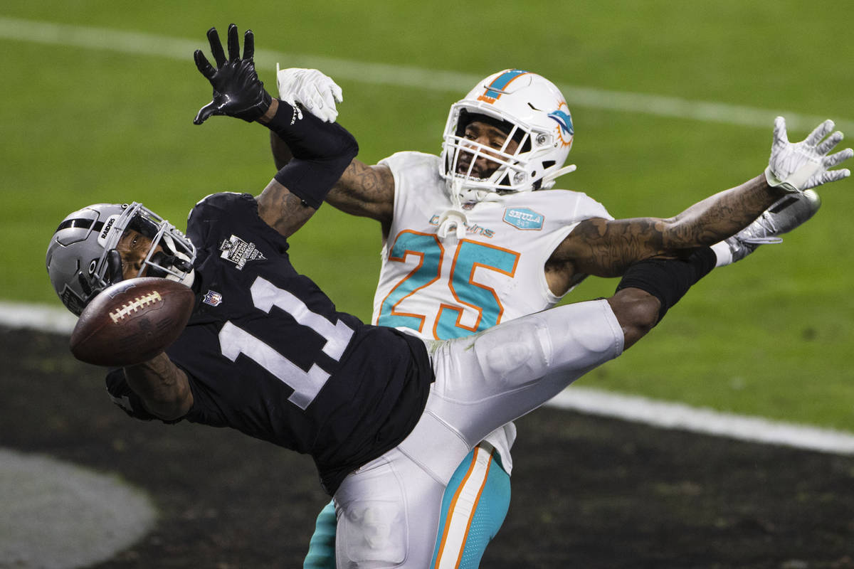 Raiders wide receiver Henry Ruggs III (11) is unable to catch the ball as Miami Dolphins corner ...