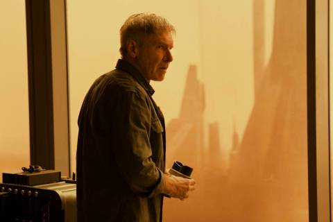 """Rick Deckard (Harrison Ford) looks out at an irradiated Las Vegas in """"Blade Runner 2049."""" (Step ..."""