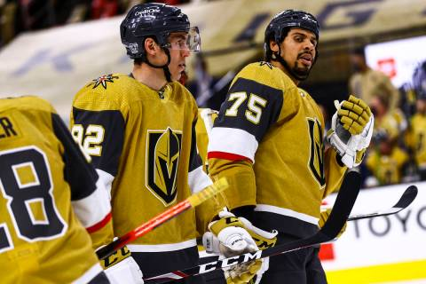 Golden Knights left wing Tomas Nosek (92) and Golden Knights right wing Ryan Reaves (75) look o ...