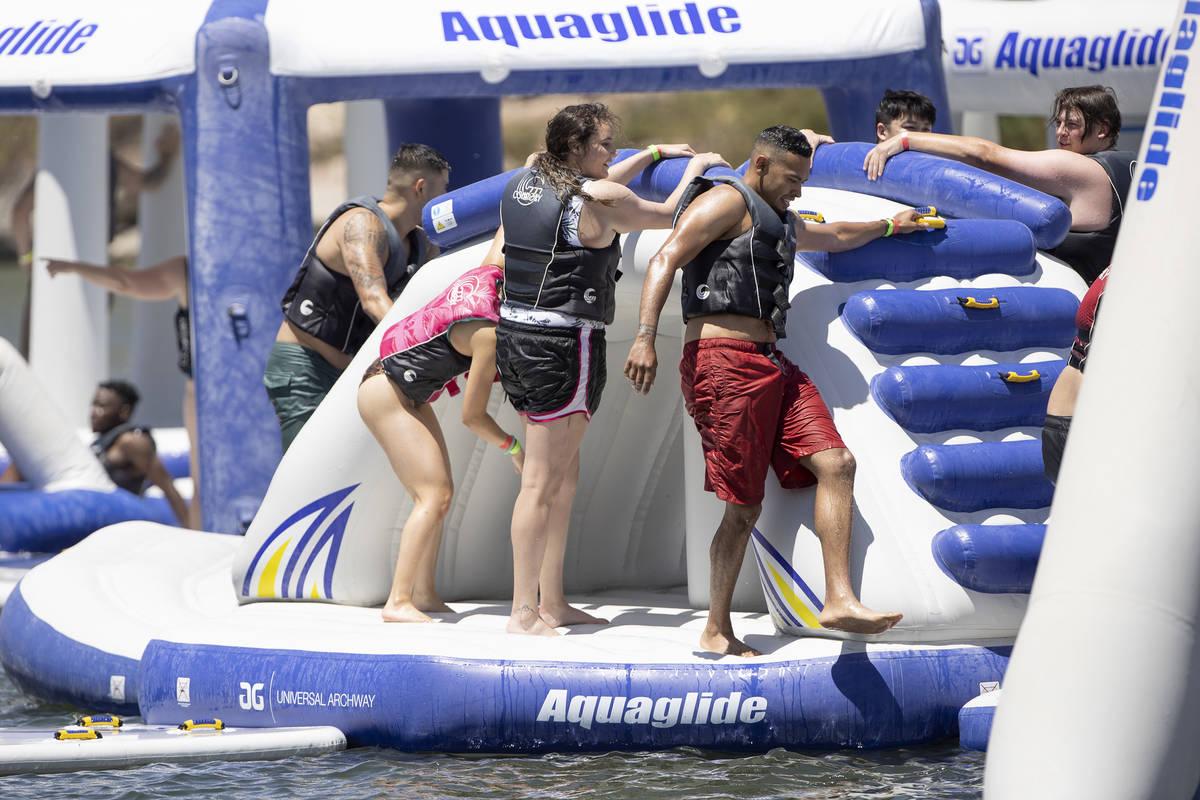 People enjoy the aqua park at Lake Las Vegas Water Sports on Saturday, May 15, 2021 in Henderso ...