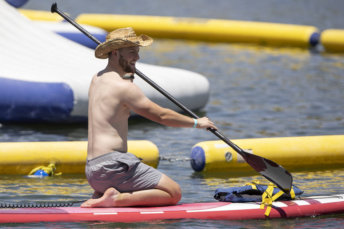 A paddle boarder makes his way out on the water at Lake Las Vegas on Saturday, May 15, 2021 in ...
