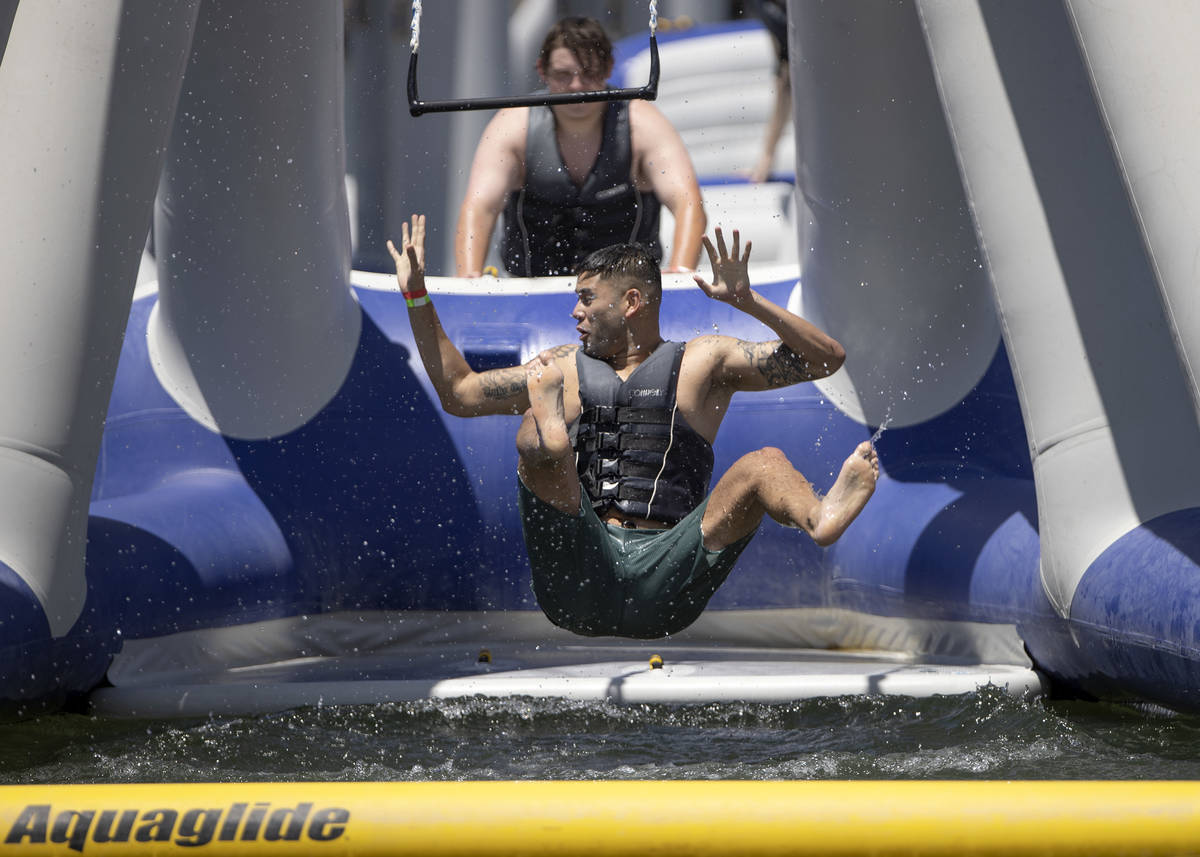 People cool off at the aqua park at Lake Las Vegas Water Sports on Saturday, May 15, 2021 in He ...