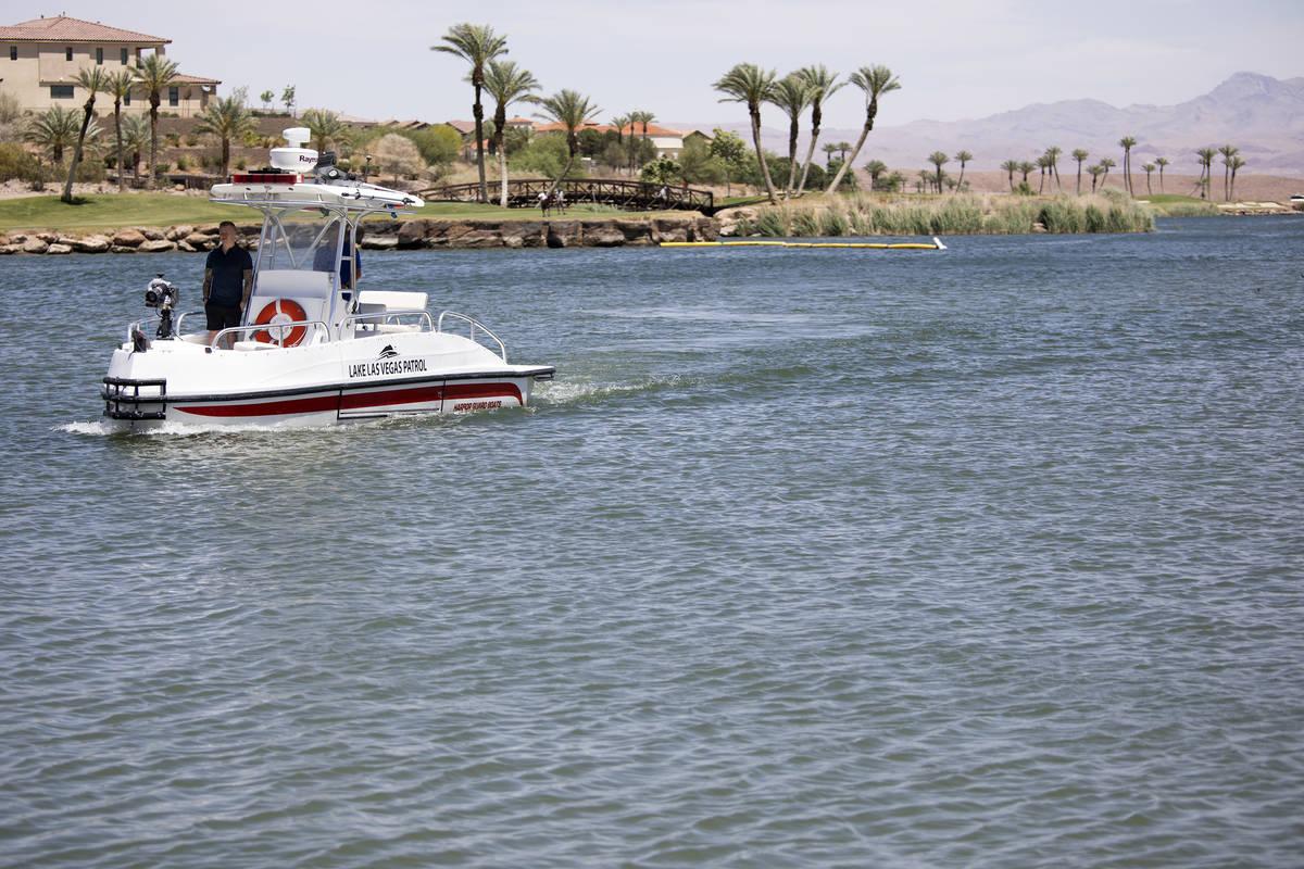High winds ripple the water as Lake Las Vegas Patrol drives around the water at Lake Las Vegas ...