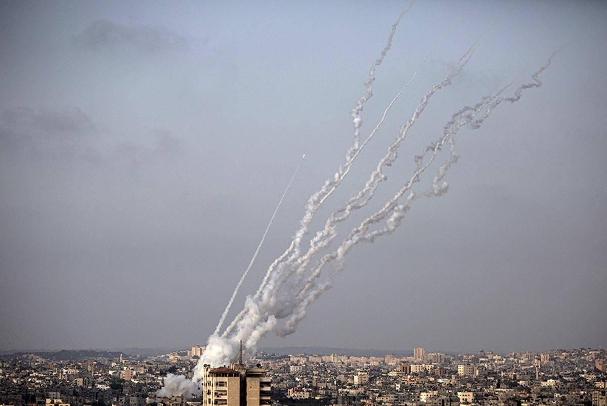 Rockets are launched from the Gaza Strip toward Israel, Monday, May. 10, 2021. (AP Photo/Khalil ...