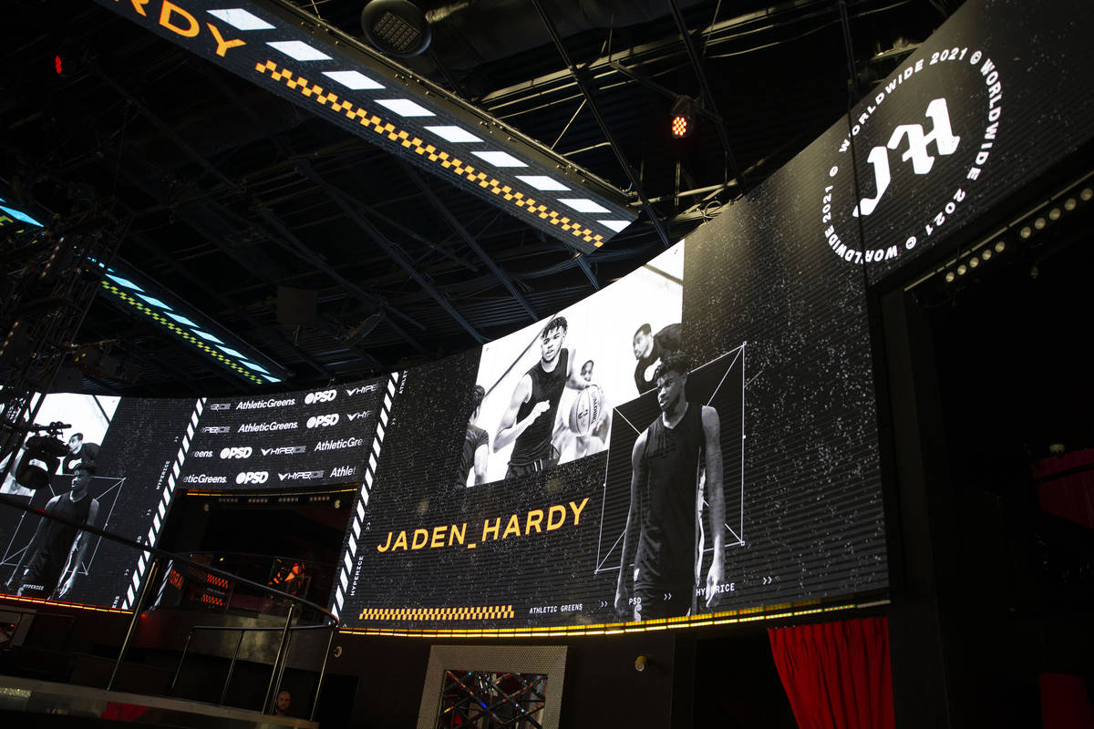 Draiճ nightclub at The Cromwell shows screens with Jaden Hardy, a Coronado High School ba ...
