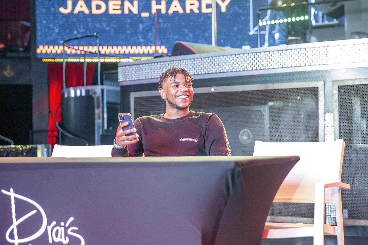 Jaden Hardy, a Coronado High School basketball prospect, streams on his phone at an event to an ...