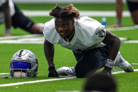 Las Vegas Raiders wide receiver Henry Ruggs III (11) stretches during a practice session at the ...