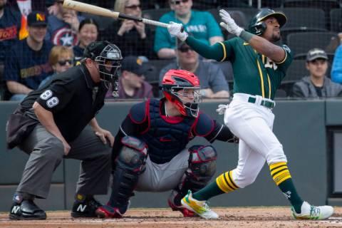 Oakland Athletics second baseman Tony Kemp (5) drives a ball to right field in the second innin ...