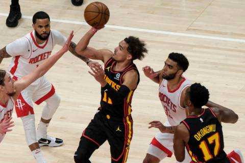 Atlanta Hawks guard Trae Young (11) shoots against the Houston Rockets during the first half of ...