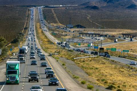 Holiday weekend traffic gets heavier at the state line as vehicles move northbound on Interstat ...