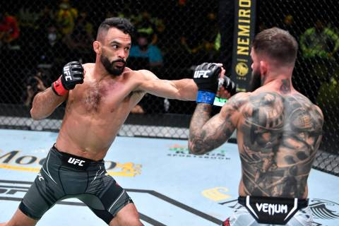 Rob Font punches Cody Garbrandt in their bantamweight bout during the UFC Fight Night event at ...