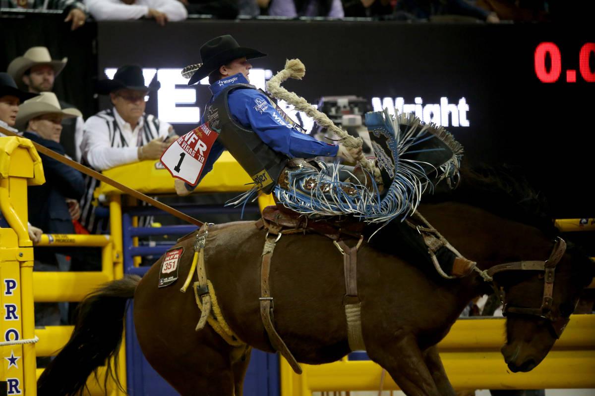 Ryder Wright of Milford, Utah, rides Toma Jo in saddle bronc riding during the Wrangler Nationa ...