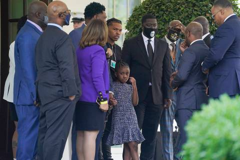 Members of the George Floyd family, including Floyd's daughter Gianna, center, talk outside the ...