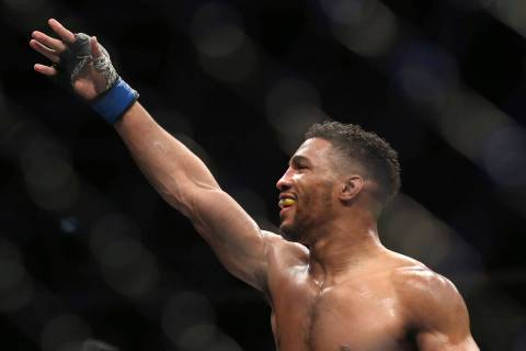 Kevin Lee celebrates his win over Edson Barboza after their fight was stopped in the fourth rou ...