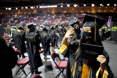 Clark High School graduate Sydney Lin waves to her family after a graduation ceremony at the Or ...