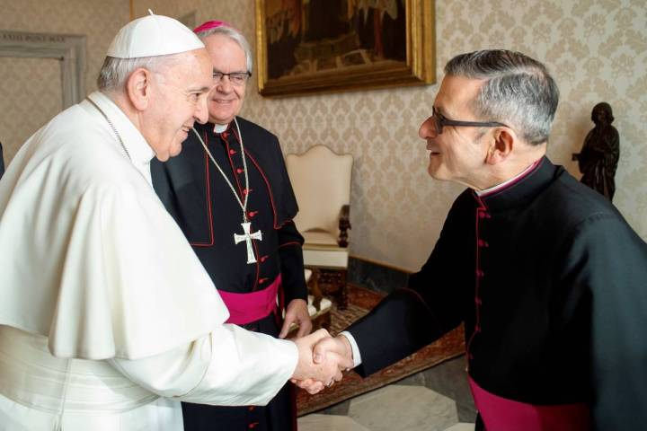 Monsignor Gregory Gordon, right, is seen in a January 2020 photo with Pope Francis, left, and L ...