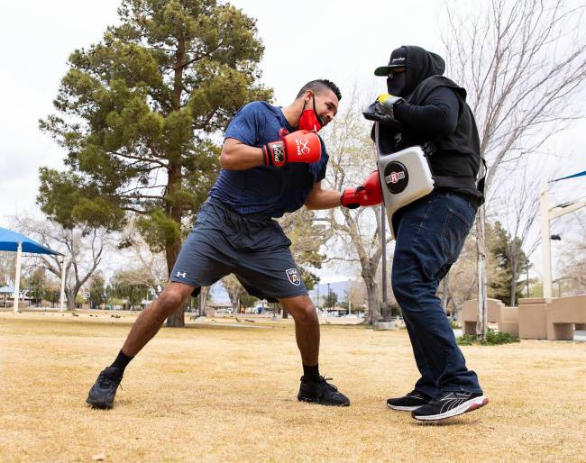 Rahim Gonzales, trains with his trainer Tyrone Herbert at Lorenzi Park, on Tuesday, March 9, 20 ...
