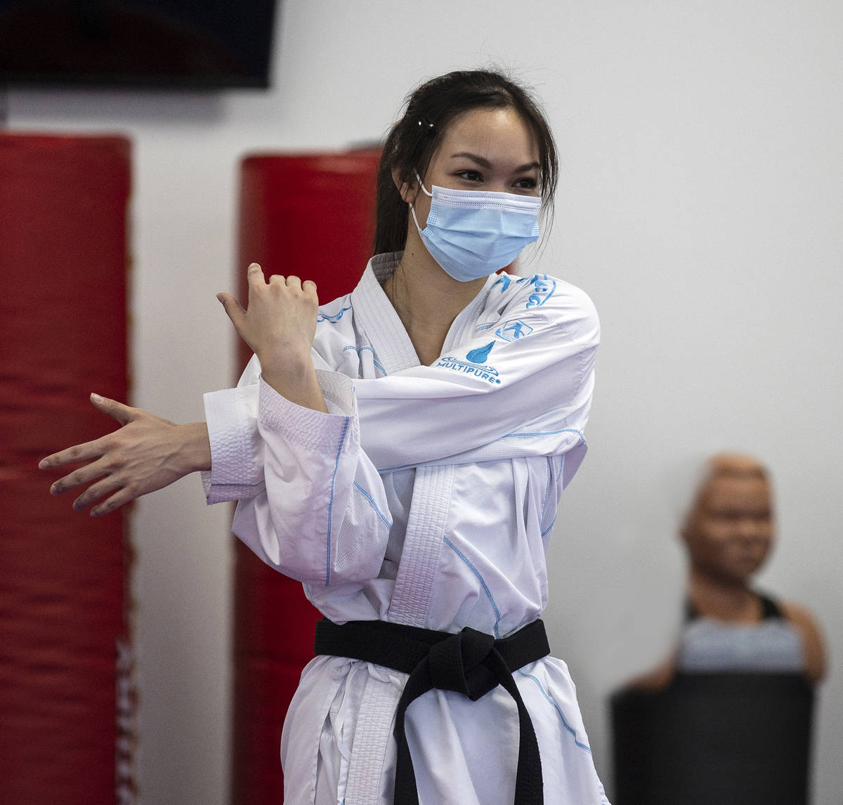 Trinity Allen stretches at her father's karate studio. Allen is preparing to qualify for the U. ...