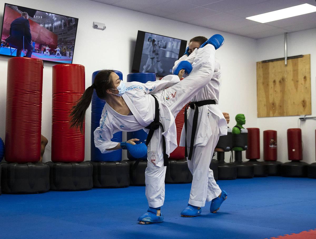 Trinity Allen, 20, left, trains at her father's karate studio. (Bizuayehu Tesfaye)