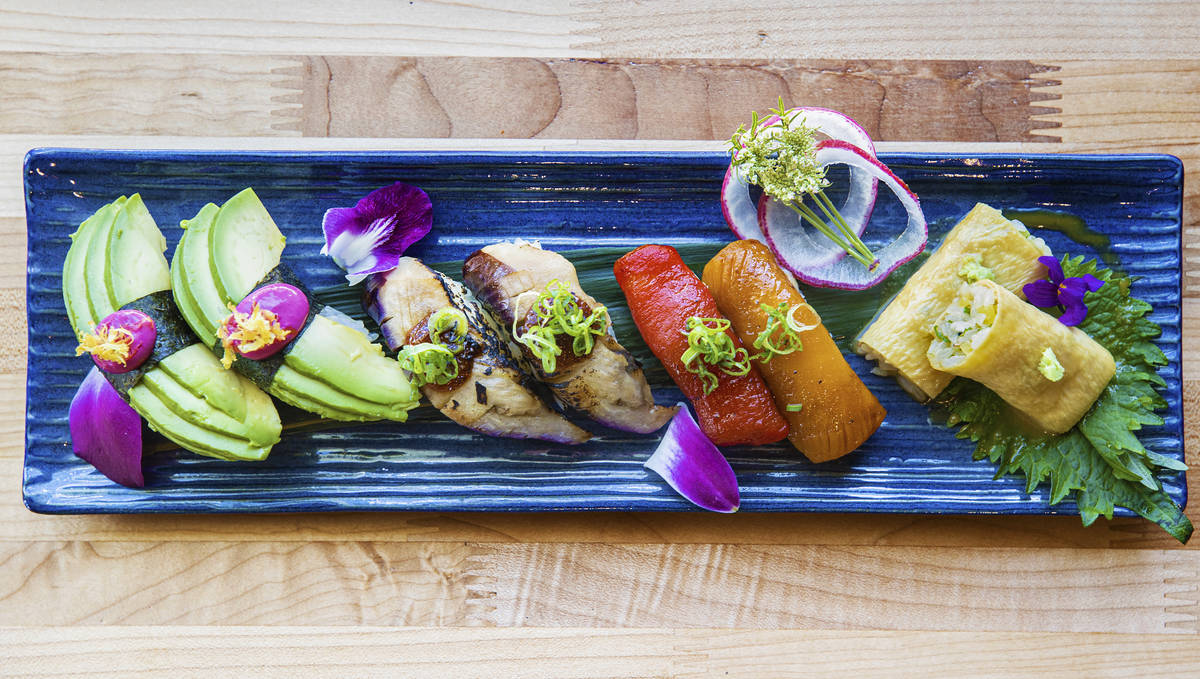 Avocado, torched eggplant and two varieties of roasted peppers take the place of fish in a sele ...