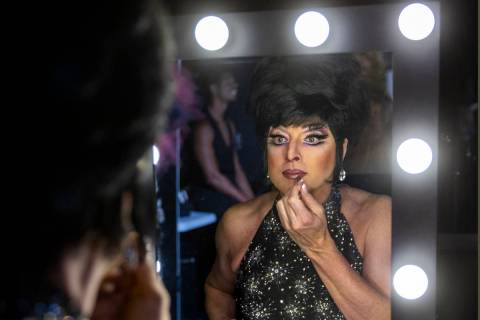 """Edie puts the finishing touches on her makeup in the dressing room before another """"Faaabul ..."""