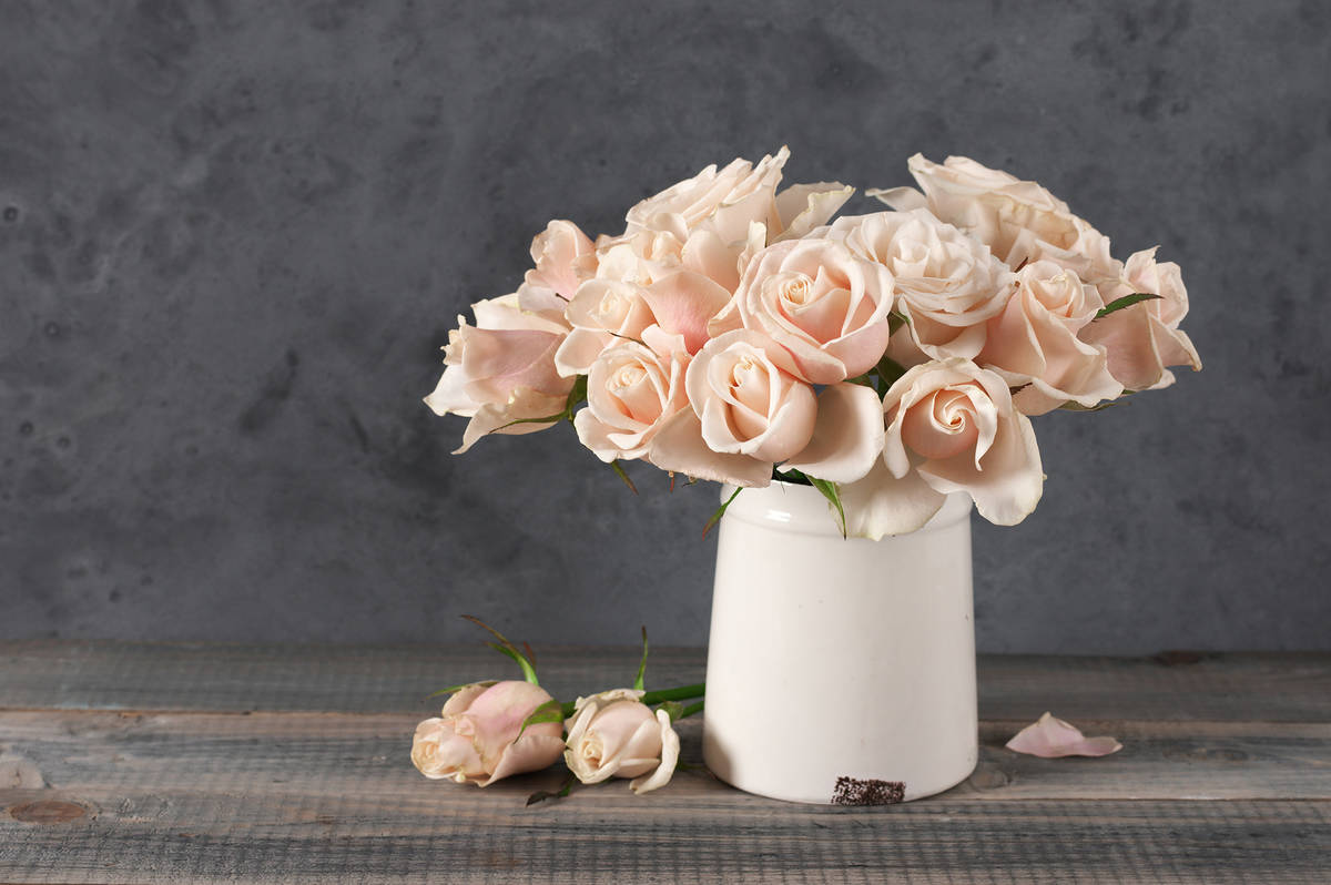 Fresh or faux flowers can add some life to rooms. (Getty Images)