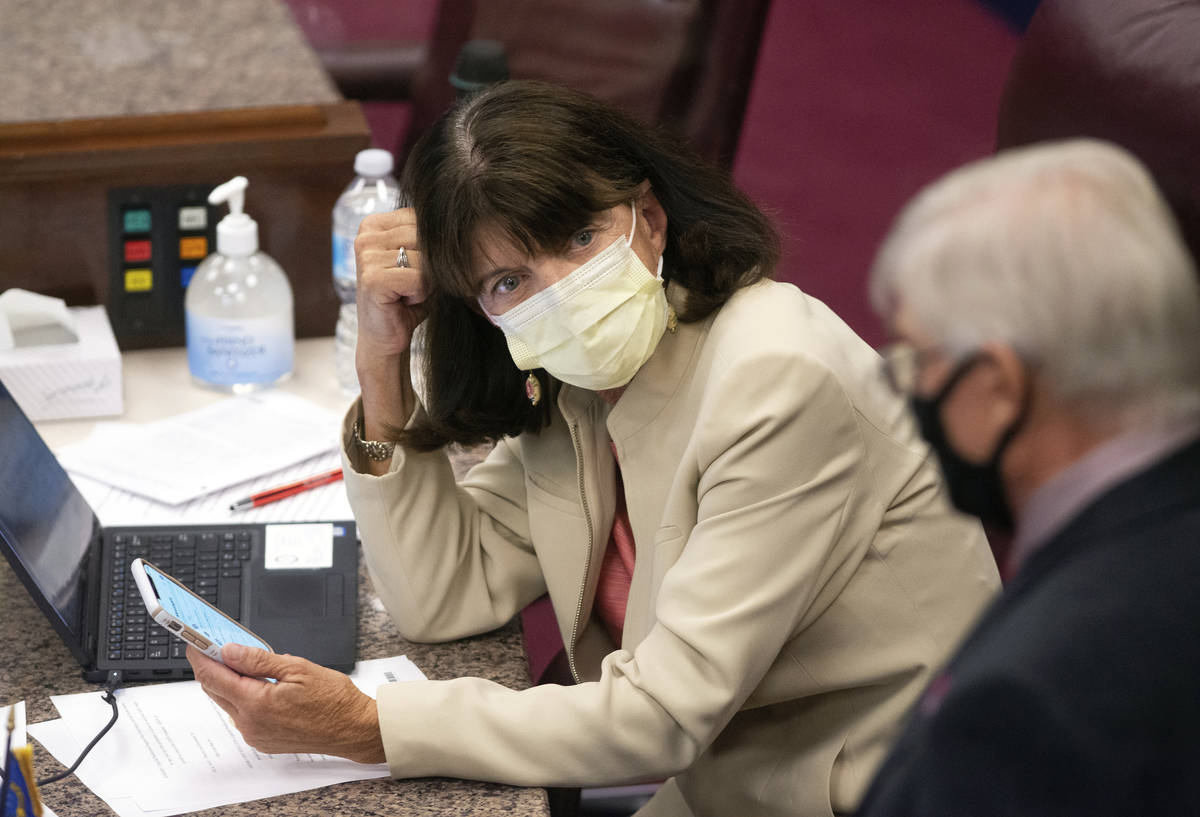 FILE - In this July 14, 2020, file photo Nevada Assemblywoman Robin Titus looks toward a collea ...
