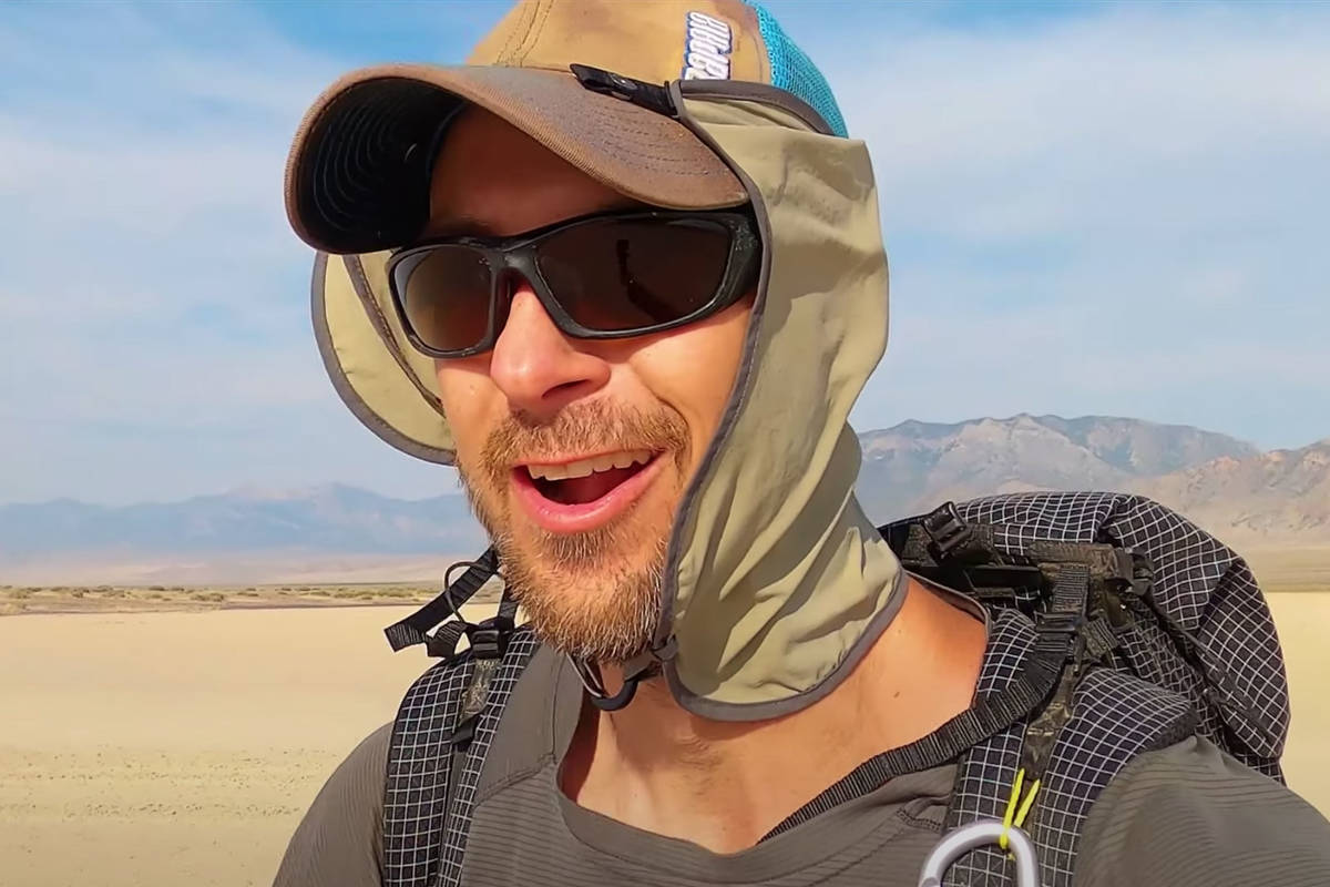 """In this image from video, Eric Poulin hikes along a new route he christened the """"Basin and Rang ..."""