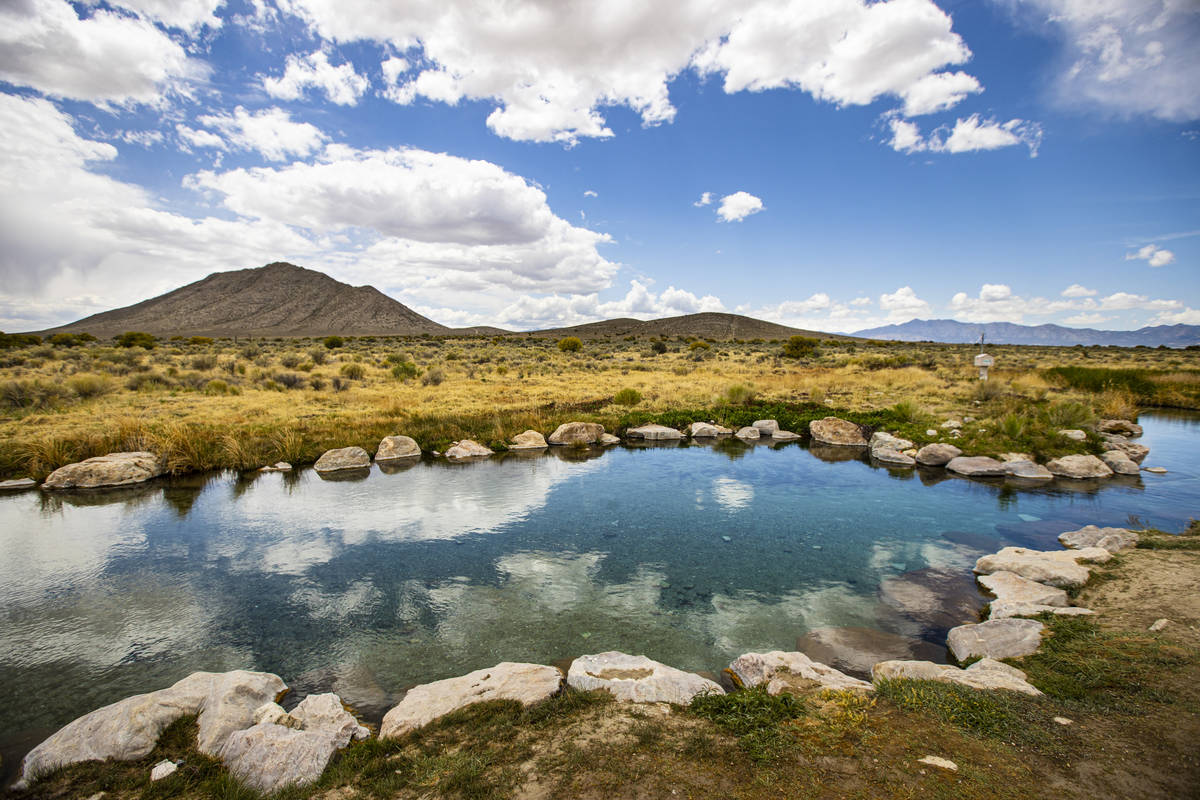 The sky reflects in the water of the Hot Creek Springs and Marsh at the Wayne E. Kirch Wildlif ...