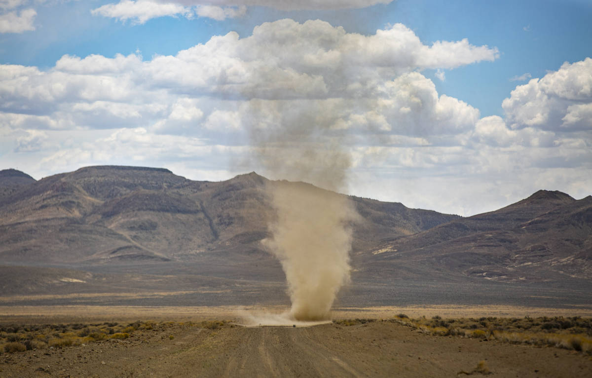 A dust devil moves around a dirt road in the Hot Creek Range along the Basin & Range trail ...