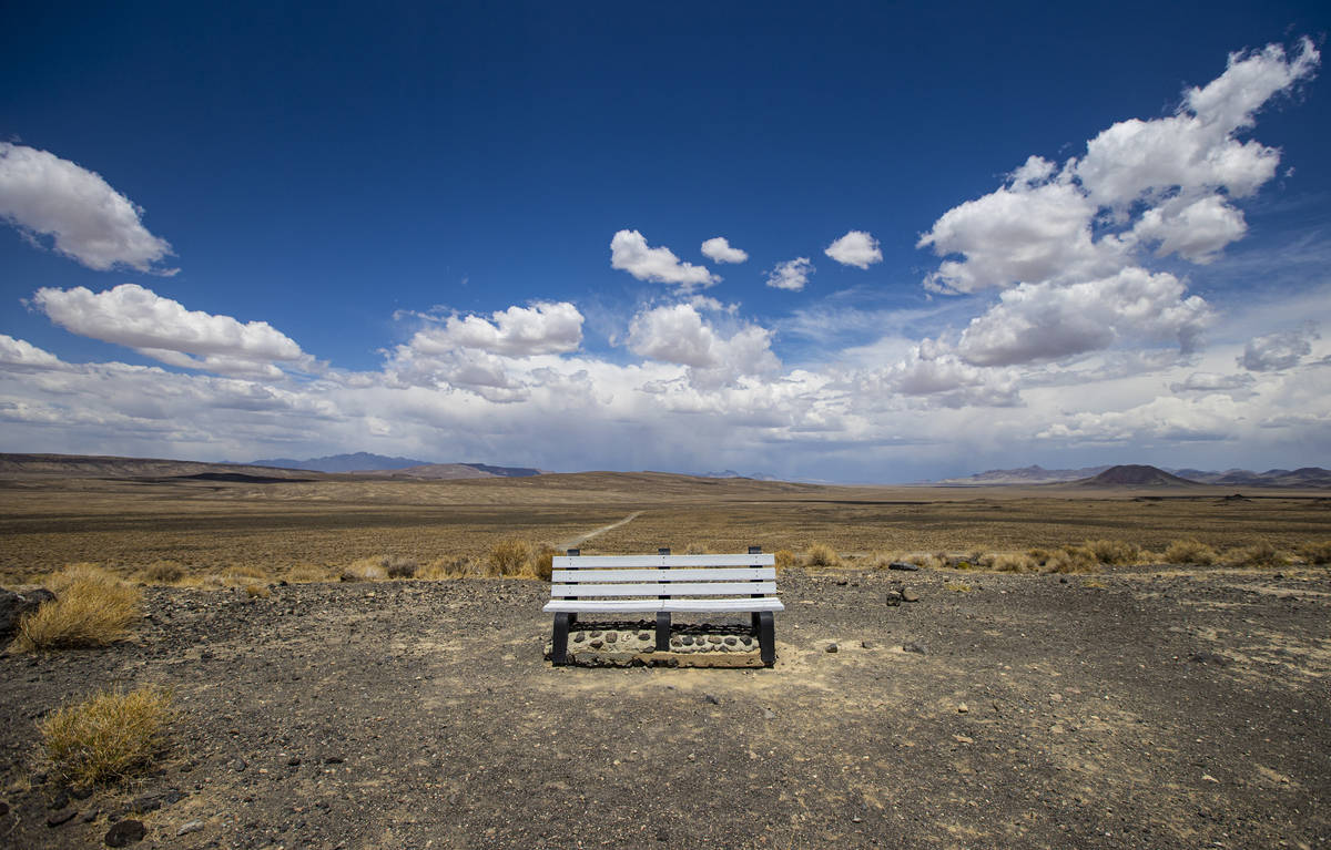 A bench at the Lunar Crater national natural landmark, located in the Pancake Range, along the ...