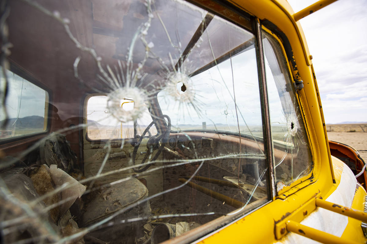 Bullet holes are seen in the windows of an abandoned 1950s International R190 truck in the Hot ...
