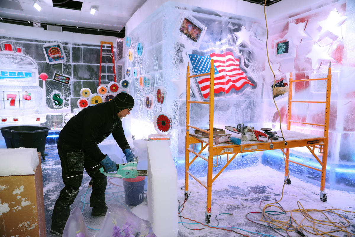 Ice artist Peter Slavin carves an ice piece at the Icebar at the LINQ Promenade in Las Vegas, T ...