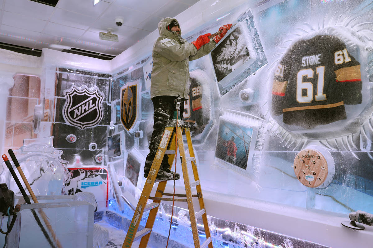 Ice artist Marco Villarreal works on a hockey themed wall at the Icebar at the LINQ Promenade i ...