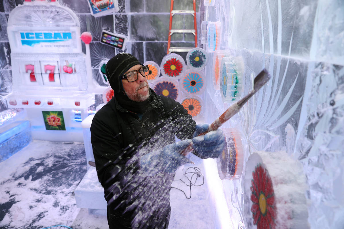 Ice artist Peter Slavin carves a design on a wall at the Icebar at the LINQ Promenade in Las Ve ...
