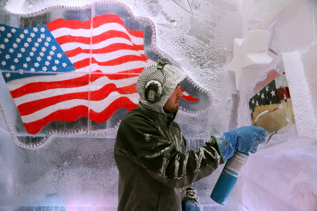 Ice artist Austin Greenleaf cleans an ice piece at the Icebar at the LINQ Promenade in Las Vega ...