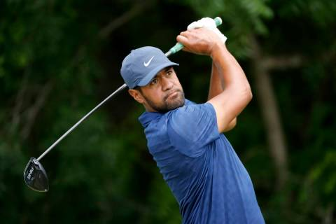 Tony Finau follows through on his shot off the sixth tee during the third round of the Charles ...