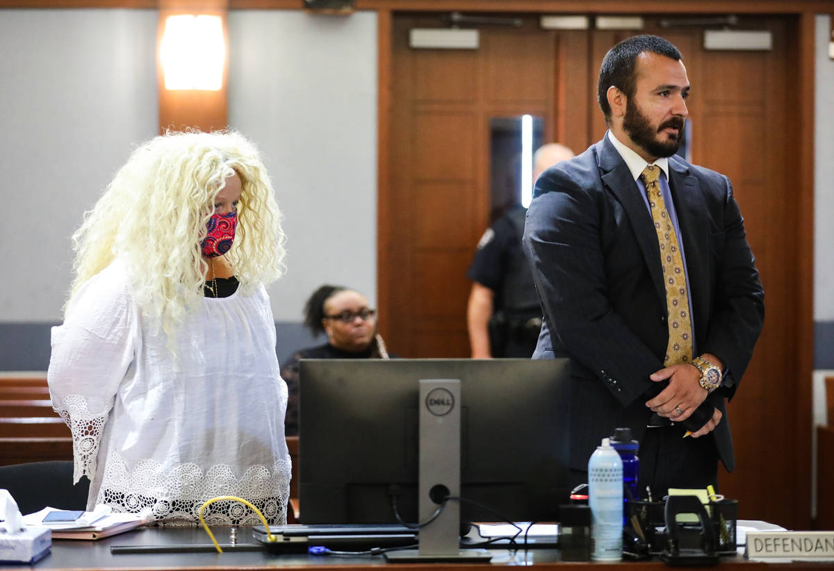 Suzy Niffenegger, left, at an eviction hearing with her attorney Christopher Storke, right, on ...
