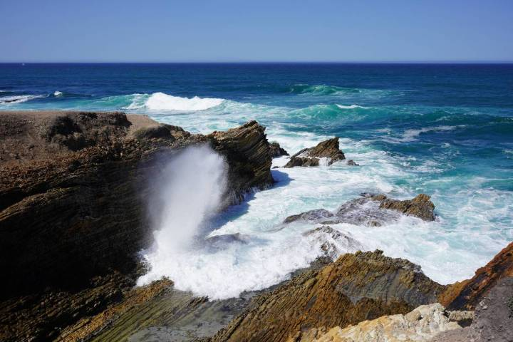 Rocks getting battered by the surf at Montana de Oro State Park on California's central coast ...