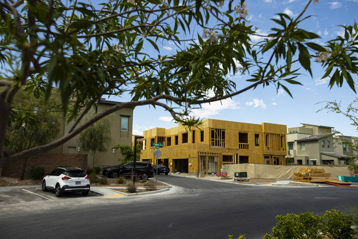 Construction continues on town homes and condominiums at Affinity by Taylor Morrison in Summerl ...