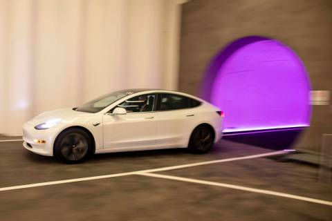 A Tesla electric car enters Central Station of the Boring Company's Convention Center Loop at ...