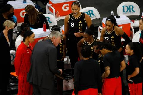 Las Vegas Aces players get together withLas Vegas Aces head coach Bill Laimbeer, center, before ...